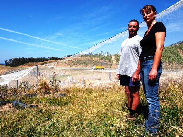 HIGHWAY TO HELL: Michelle and Jason Lloyd are losing sleep during construction of the Sapphire to Woolgoolga Pacific Hwy upgrade. Photo: CRAIG HOGGETT / Woolgoolga Advertiser