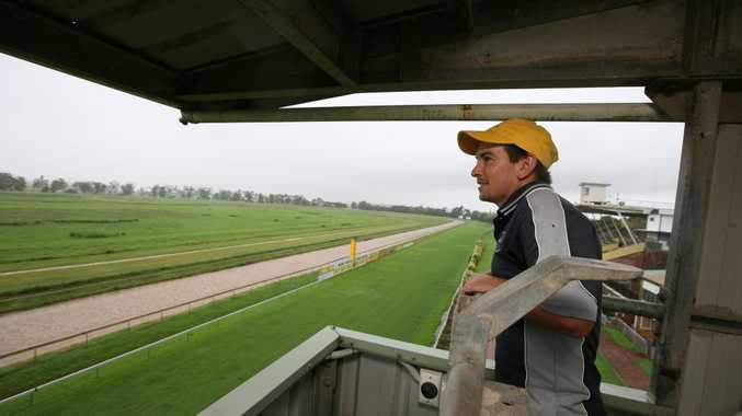 Groundsman and Jockey Nathan Patchett, who hasn't been able to race for at least a month, looks over a rain-soaked Oooralea Race Course. Photo Lee Constable / Daily Mercury