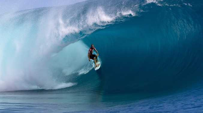 Owen Wright in full flight at Teahupo'o. Wright is out of action for the rest of the year with a back injury.