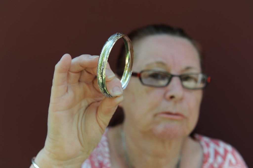 LOST PROPERTY: Sue Robertson holds her silver bracelet that she found in a Bundaberg Op Shop. Sue thought it had been lost to the council dump after the January floods. Photo: Mike Knott / NewsMail