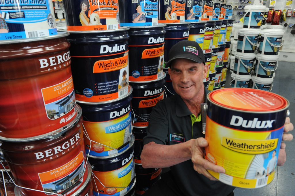 WEATHERSHIELD: Inspirations Paint, store manager Rodney Mason with some of the $10,000 worth of paint that will be donated to the community rebuild project, which involves volunteers fixing flood affected homes in Bundaberg and North Burnett. Photo: Mike Knott / NewsMail