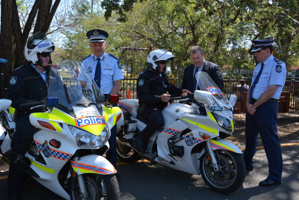 Deputy commissioner Ross Barnett, Police Minister Jack Dempsey and acting assistant commissioner Michael Keating, speaking to uniform police.