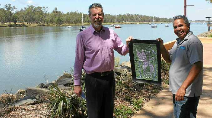 DRY TIMES: 'Rain man' Barry Boland (right) explains his painting of brolgas during the wet season to local weatherman Mike Griffin.