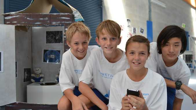 Fitzgerald State School students Nathan Sheehan, Callum Rebetzke, Liliy Tarlinton and Tyler Forbes with their 'Loo locator' displayy advertising their app design. Photo Lee Constable / Daily Mercury