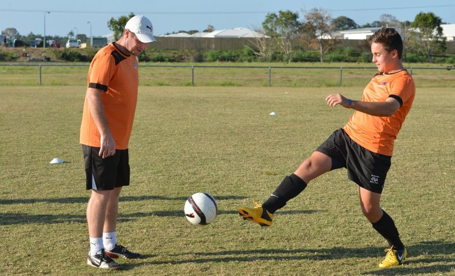 Scott MacNicol , left keeps an eye on Isaac Galea at the Roar coaching clinic in Mackay. Photo Peter Holt / Daily Mercury