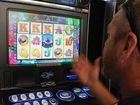 A Poker Machine player tries his luck. Photo: Karleila Thomsen / Fraser Coast Chronicle