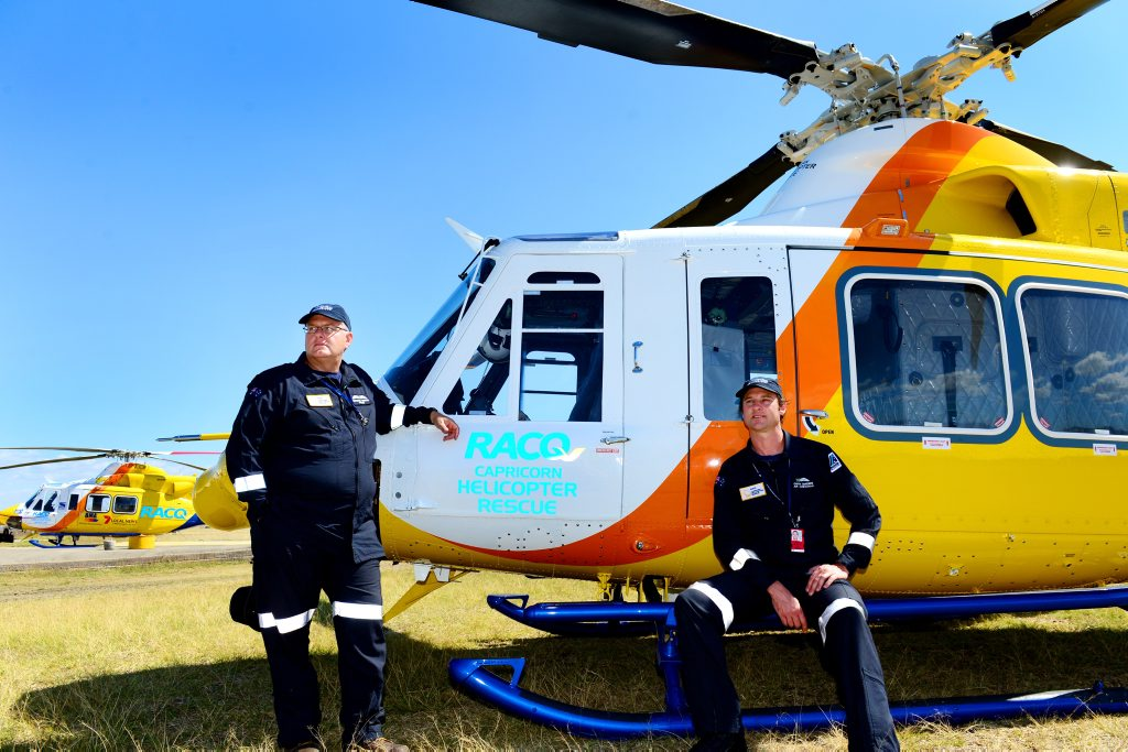 Pilot Mitch Vernon and air crewman Garth Snaidero with the RACQ Capricorn Helicopter Rescue chopper.