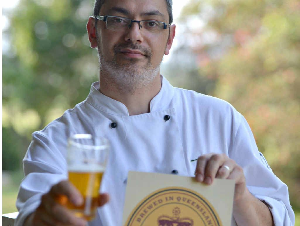ACE ALE: George Isaac admires his unique Gunabul Golden Ale creation.