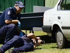 DRIVE-BY: Forensic police inspect a bullet hole (circle) during their investigation of a drive-by shooting that happened in Melinda St, Camira.