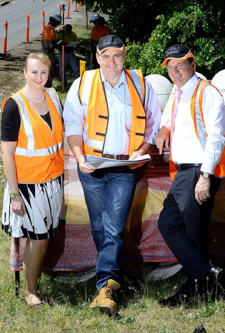 BIG PROJECT: Cr Cheryl Bromage, James Long from CPM and Ipswich Mayor Paul Pisasale inspect works in Redbank Plains.