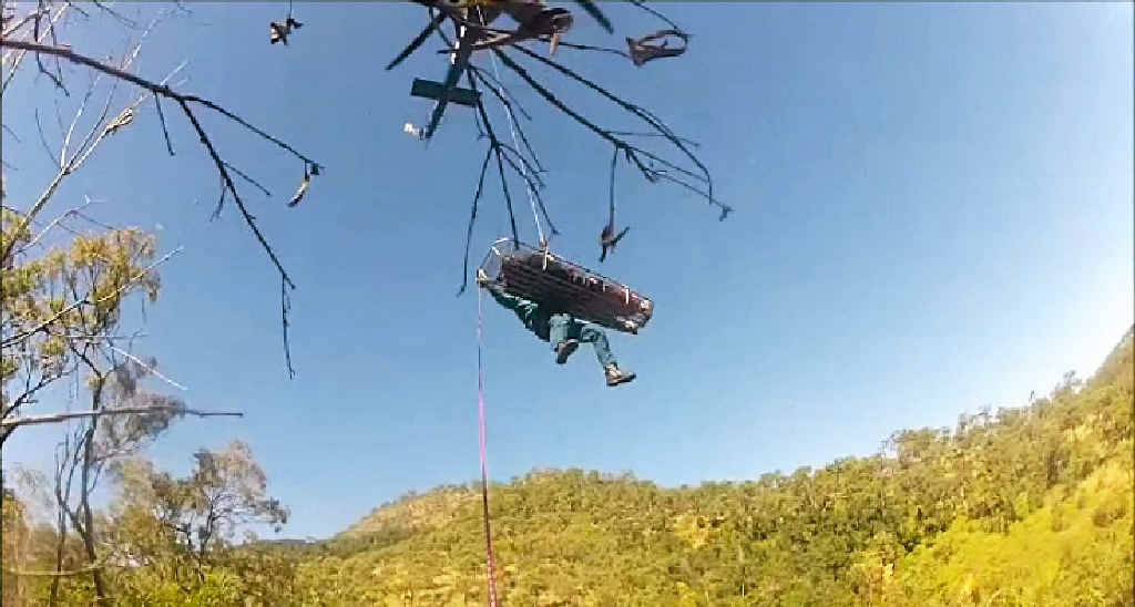 The RACQ Capricorn Rescue Helicopter Service rescues Jasmine Henning from Mt Archer.