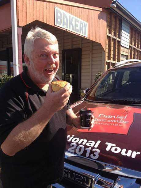 Bruce Morcombe tucks into a crocodile pie at Blackbutt Bakery.