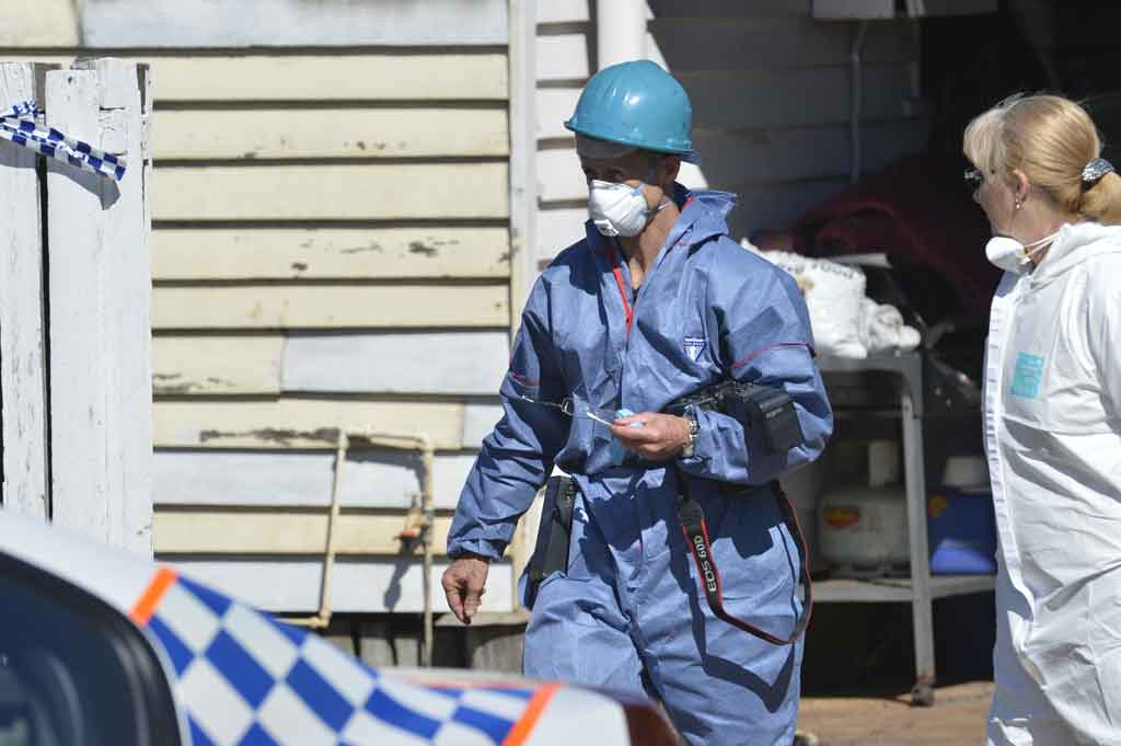 Fire investigators at the scene of a fatal house fire in North Toowoomba.