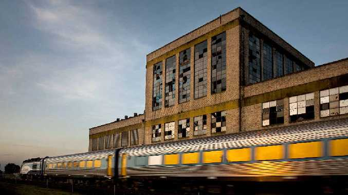 PIECE OF CITY'S TAPESTRY: Peters Factory and the 5.30pm train. All photos: Victoria Cooper and Doug Spowart