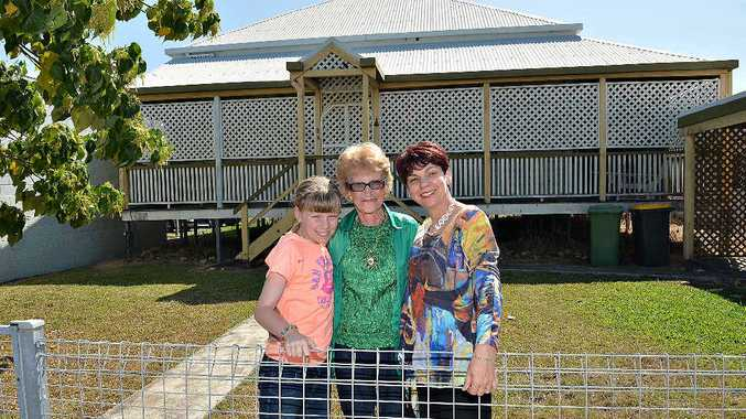 Effie Mulherin, centre, with her great niece Ella Woolee and niece Janette Mulherin outside the inner city home Effie has lived in all her life.