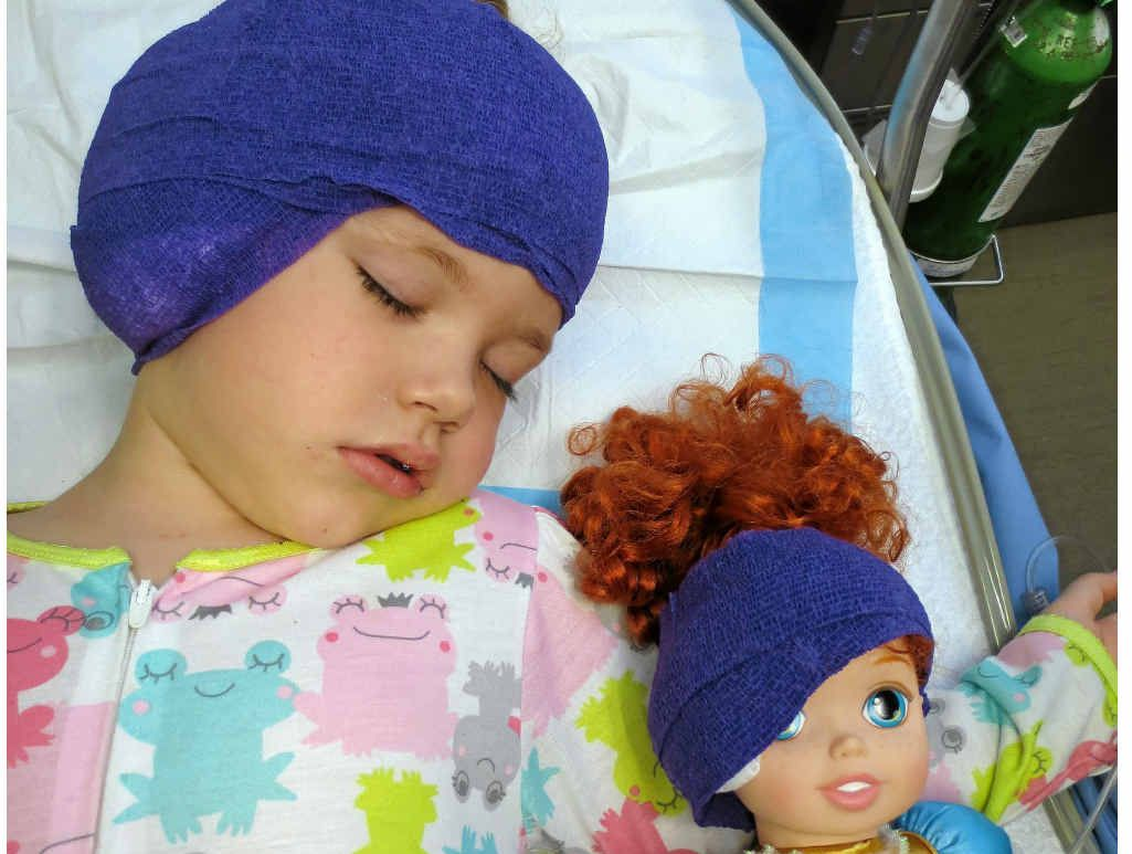 COMFORTING CAPS: Frankee-Lee's doll joins her in the recovery suite after her ear surgery.