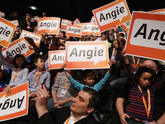 Votes for Angela: But will they be enough? Supporters in Berlin, yesterday