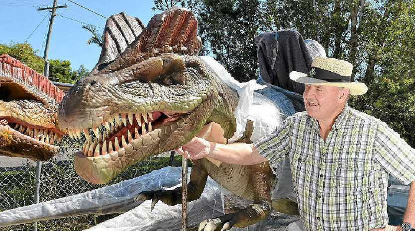 NEW ADDITIONS: Palmer Coolum Resort general manager Bill Schoch welcomes the arrival of the new dinosaurs for the resort.