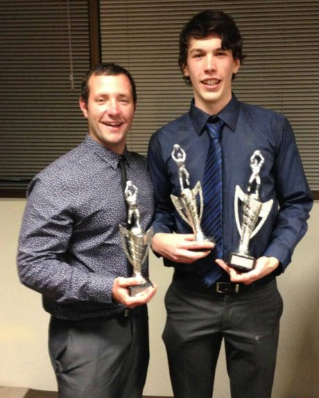 CLOSE COUNT: Ipswich Eagles' Best and Fairest player Matthew Uebergang (right) and award runner-up Chris Devlin accept their trophies at the Ipswich Turf Club on Saturday night.