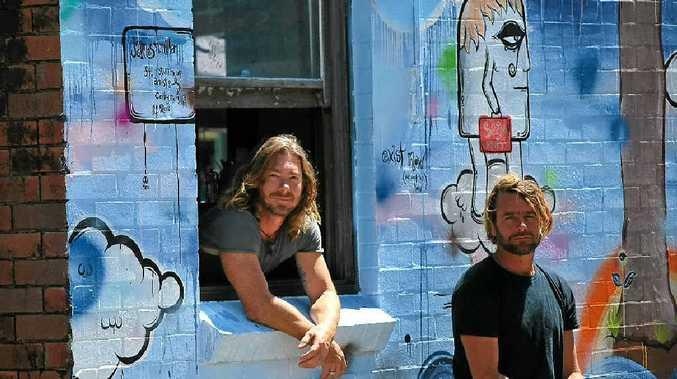STREET ART: Bayleaf Cafe owner Dan Readman and artist James McMillan look over the freshly painted wall mural.
