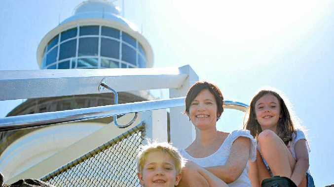 LONG WAY TO THE TOP: At Cape Byron Lighthouse on the first day of the holidays was the Donovan family from Brisbane, Parker, 6, mum Tricia and Amelia, 9.