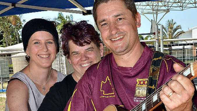 FUNDRAISING SUPPORT: Shelley Knight, Andrea Pinkard and entertainer Matt Knight (above) help raise money for Mackay woman Andrea Sauer at Walkerston on Saturday.
