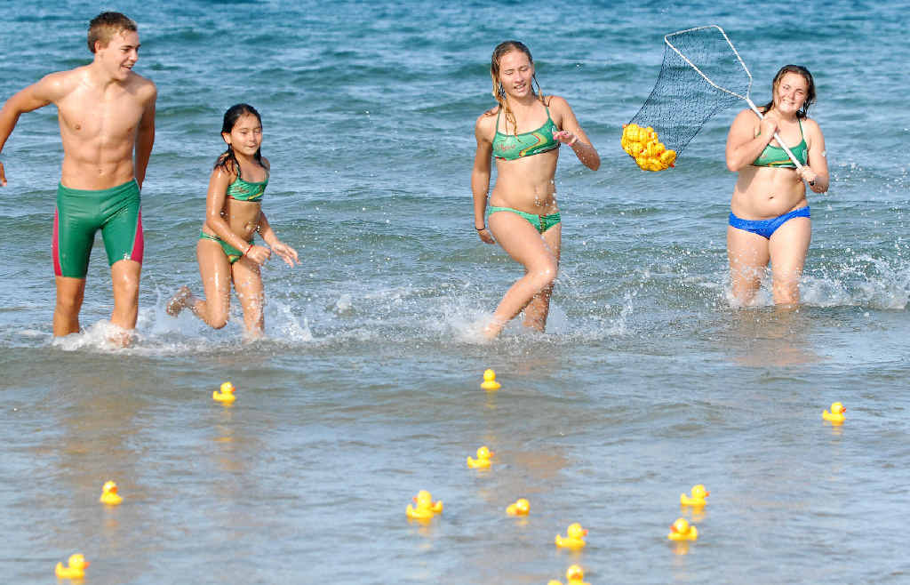 Ben Brotherson, Klara and Keesha Close and Erin Brotherson chase rubber ducks at Mackay Harbour.