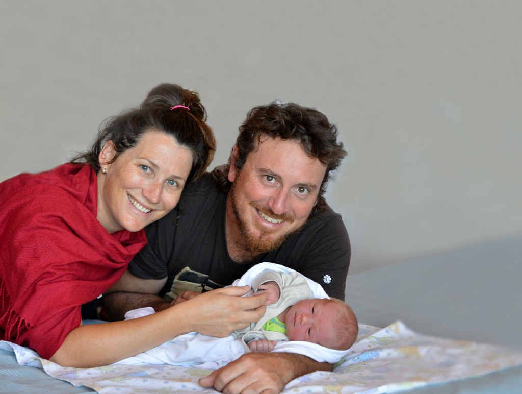 Elise and Scott Hanlon with their daughter Francis Grace, who was born in the family car, just like her mum.