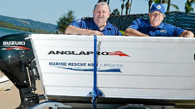 RAFFLE PRIZE: No, not John Donoghue and Peter McMahon from Marine Rescue Ballina, the boat is the prize.