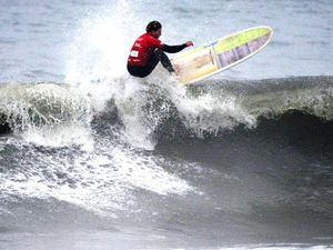 Neal shines on the waves while wearing the green and gold