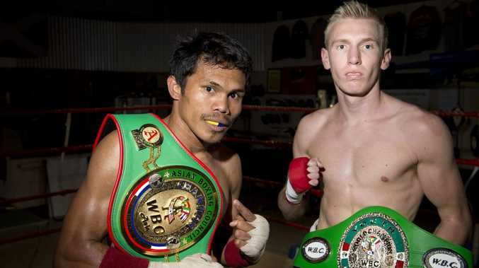 Jack Asis (left) and Brayd Smith get a brief look at the title belts they'll fight for in Toowoomba next Friday night.