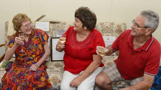 CHEERS: Irene Crispin of Grafton celebrates her 100th birthday with two of her children, Maxine Gleeson and Neville Crispin. PHOTO: ADAM HOURIGAN