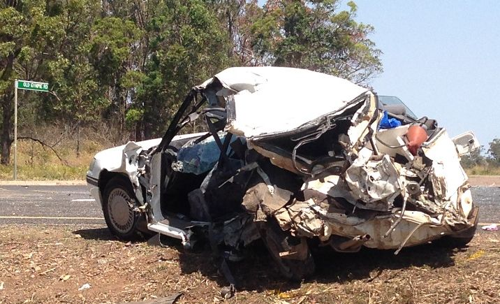 An elderly couple died in this station wagon when it was rear-ended and pushed into the path of a semitrailer on the Bruce Hwy at Glenorchy, about 10km south of Maryborough.