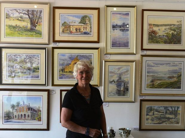 Anne Falkner with her exhibition of watercolours at her gallery. Photo Adam Hourigan / The Daily Examiner