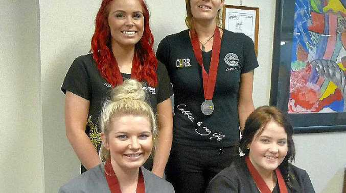 ABOVE: Victoria Edwards (back left) Michelle Cross, Breanna Rooney (front left) and Melanie Taylor wear the medals they were awarded at the WorldSkills regional finals presentation ceremony in Mackay.
