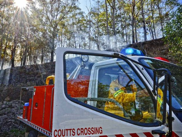 AT THE READY: Coutts Crossing RFS members keep watch on a fire south of Nymboida. Photo: Adam Hourigan