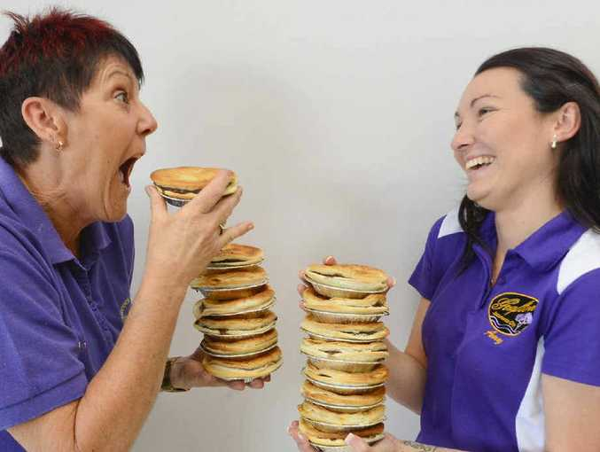 PUTTING THE BITE ON: Wendy Henwood of Henwood's Bakery with Jacaranda candidate Amy Freeman getting ready for the pie-eating competition. Photo Adam Hourigan
