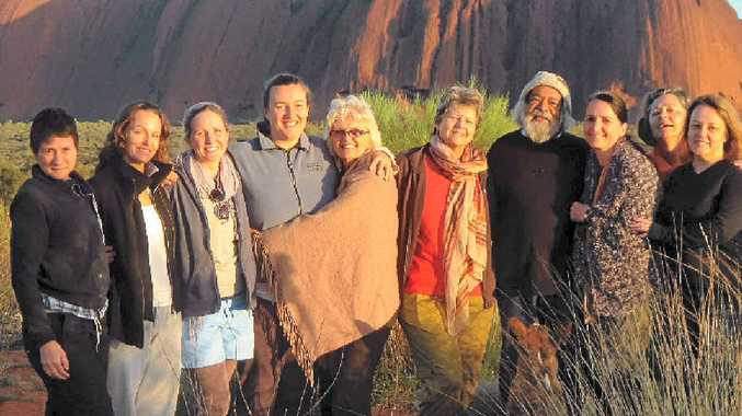 IMAGE-FREE ZONE: New Brighton Beach author Denise Greenaway (centre, with shawl) and women attending her desert retreats. Also pictured is Uluru elder Bob Randall.