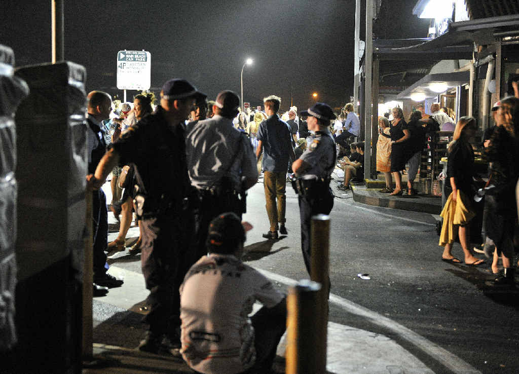 TROUBLE HOTSPOT: Police during Byron Bay New Year's Eve celebrations. Alcohol-fuelled violence is a problem in the area.