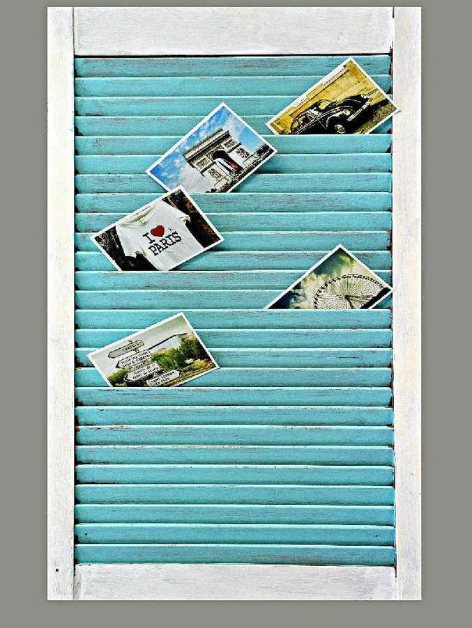 Wooden shutter to display letters and postcards.