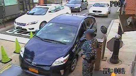 Closed circuit video shows Aaron Alexis drives a rental car through a gate at the Washington Navy Yard.