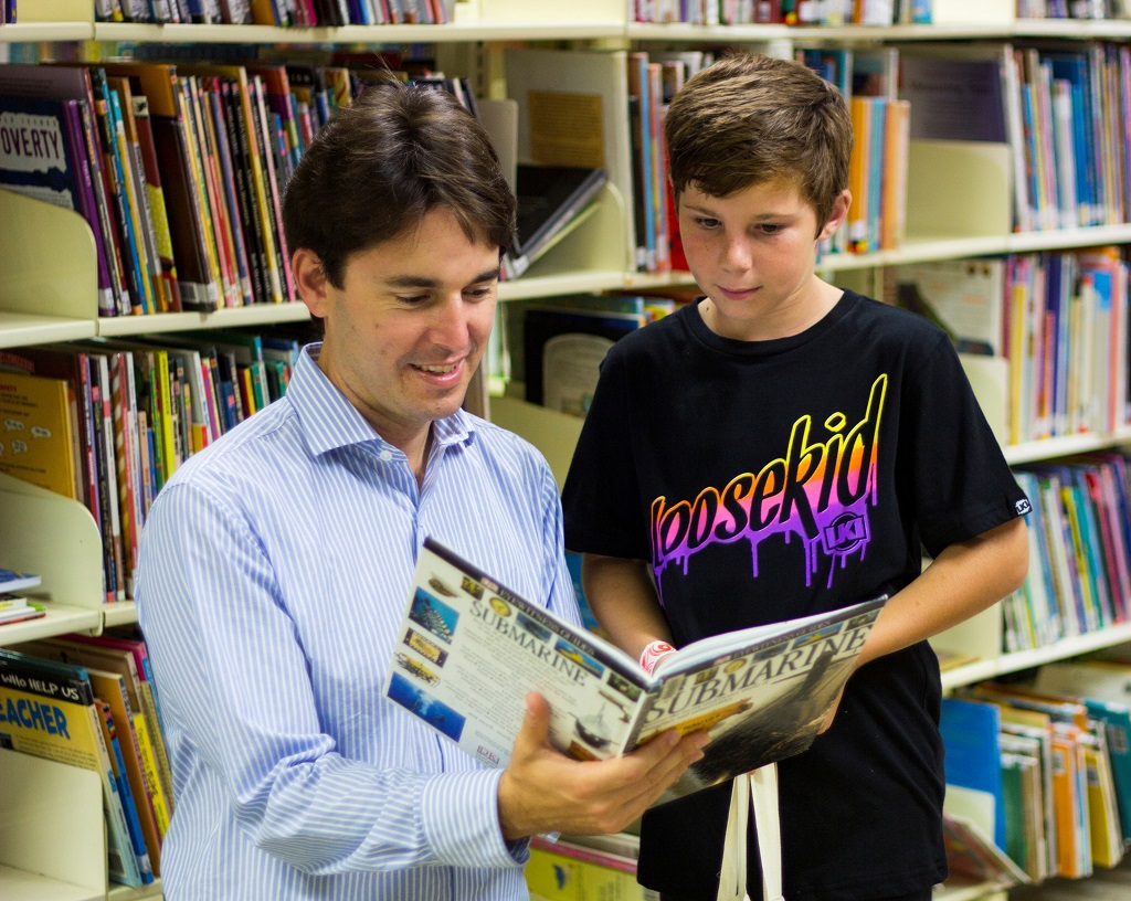 Fraser Coast councillor George Seymour enjoys a book with Ethan Dower, the 43,000th member of Fraser Coast libraries.