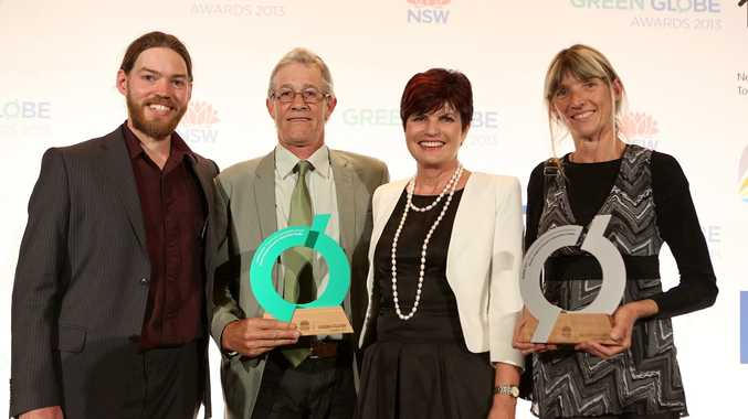 Members of the Nimbin Neighbourhood and Information Centre with NSW Environment Minister Robyn Parker (second from the right) and their Green Globe awards.