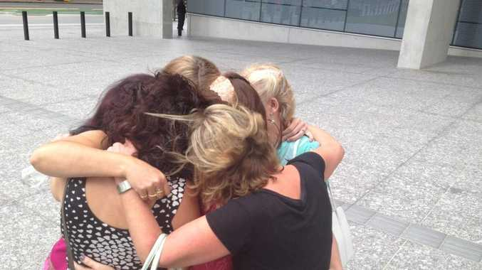 Sexual assault victims outside court after convicted rapist's sentence in April.