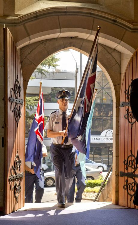 Constable Todd Atkinson leads the Flag Party at the National Police Remembrance Day ceremony held at St Lukes Anglican Church.
