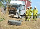 Emergency crews rush to Childers Rd after truck crashes