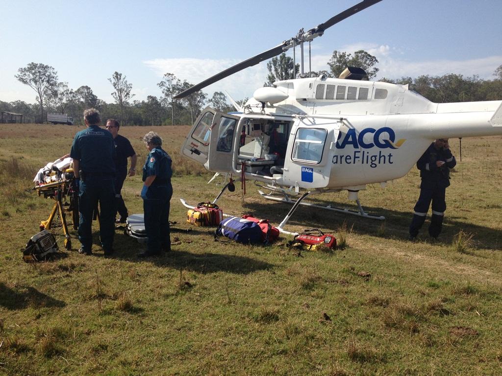 RACQ Careflight paramedics treat a man injured by a cow west of Miriam Vale.
