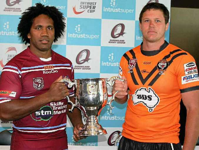 Rival captains Jardine Bobongie of the Mackay Cutters and Steven Thorpe of Easts Tigers hold the Intrust Super Cup premiership trophy ahead of the grand final.