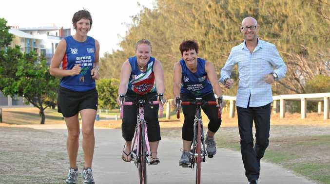 Karlee Hayden, Jenni Bailey, Sue McDowall and Des Besanko warm up for Mackay's Olympic distance triathlon.
