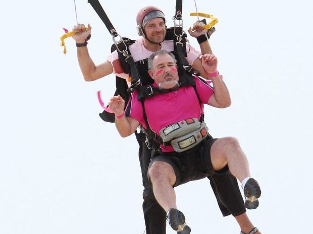 Sunshine Coast Daily general manager Grant Ferry jumps out of a plane to raise money for the Cindy Mackenzie Breast Cancer Foundation as part of Pinktober.
